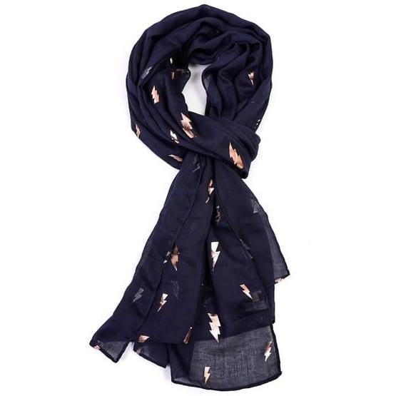 rose gold lightning motif on a navy blue scarf