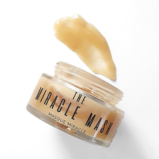 The Miracle Mask by Sienna X. The image shows the product tub with the lid off and the product smeared on the counter.