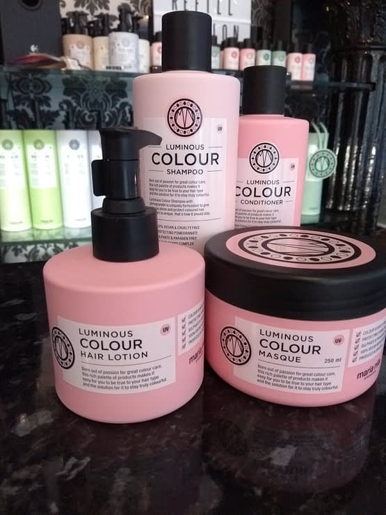 Luminous Colour by Maria Nila. The image shows the four products included in the bundle. Pink in colour with black lids.