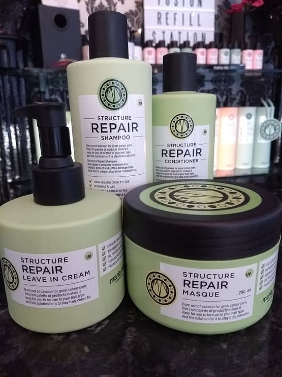 Repair by maria nila. The image shows the four products in the bundle. Green in colour with black lids