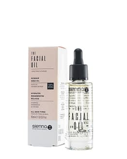 The facial oil by sienna x. This image shows the product bottle sat slightly in front to the right with the product box behind
