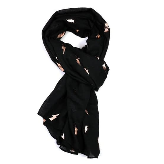 Rose gold lightning motif on a black scarf